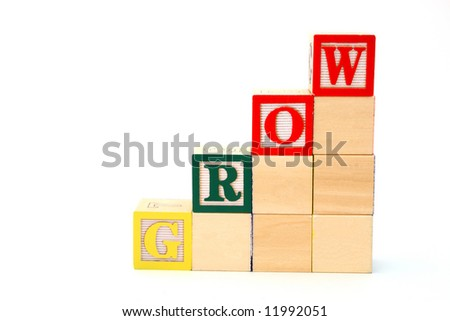 word grow formed by alphabet wood blocks on a white surface