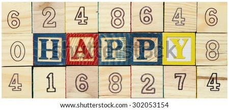 "Word ""HAPPY"" from alphabet wooden blocks - stock photo"