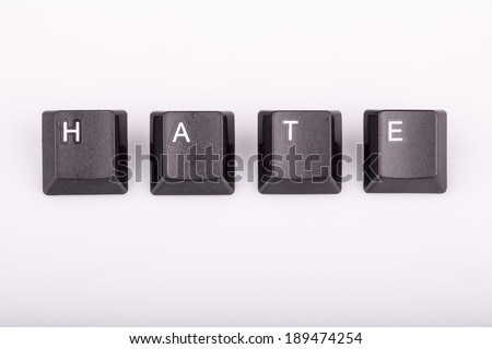 Word hate formed with computer keyboard keys on white background with shadow - stock photo