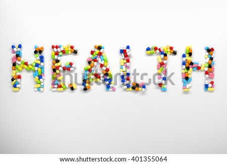 Word health made of colorful pills and capsules on white background. 3d render - stock photo