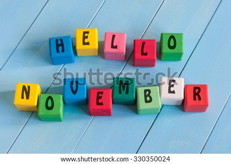 Word Hello November On child's toy cubes on wooden rural background - stock photo