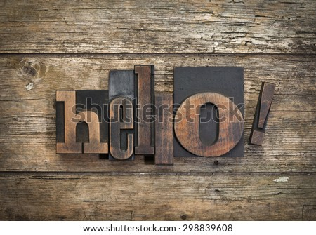 """word """"hello!"""" written with vintage letterpress printing blocks on rustic wood background - stock photo"""
