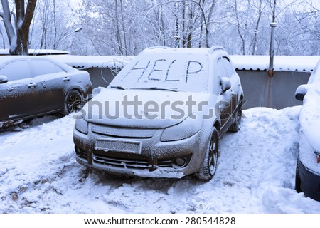 Word help on snow covered car - winter transportation problems - stock photo