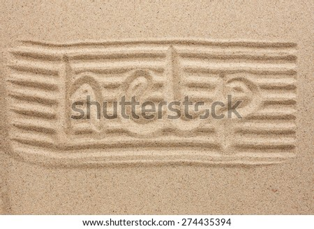 Word help written in the sand, as a background - stock photo