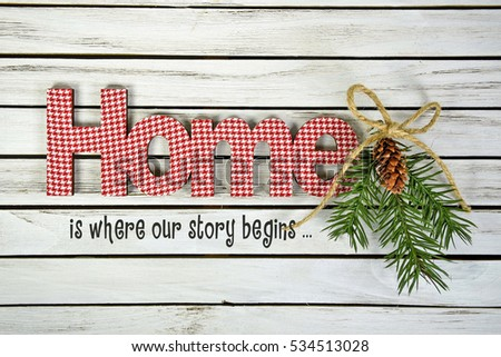 word home and inspirational quote with pine and twine bow on whitewashed wood