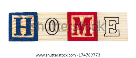 word home formed by letter wood blocks on white