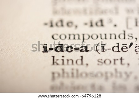 Word idea from the old dictionary, a close up. - stock photo