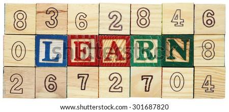 "Word ""Learn"" among alphabet wooden blocks - stock photo"