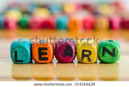 word learn on colorful wooden cubes