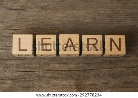 word learn on wooden cubes - stock photo