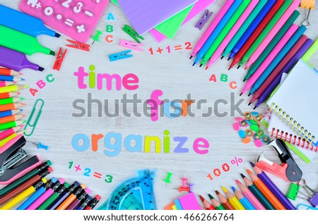 word letters time for organize and stuff for school on gray wooden desk