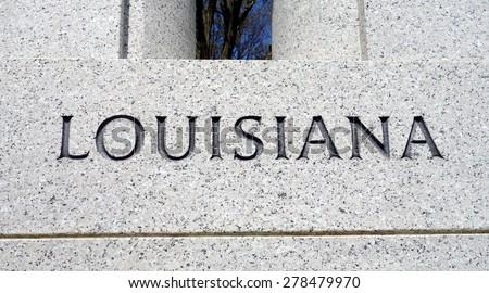 Word Louisiana engraved in the stone - stock photo