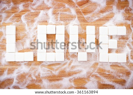 Word LOVE arranged from cube sugar; sweet concept Valentine's Day - stock photo