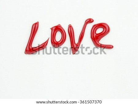 Word Love in red liquid ink on white Valentine Card