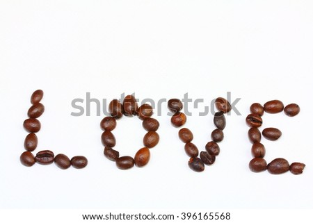 word love laid out from coffee beans isolated on white background