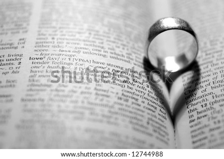 Word LOVE next to a heart-shaped shadow - stock photo