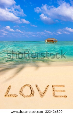 Word Love on beach - concept holiday background