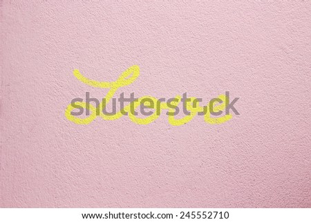 Word LOVE on cement background - stock photo
