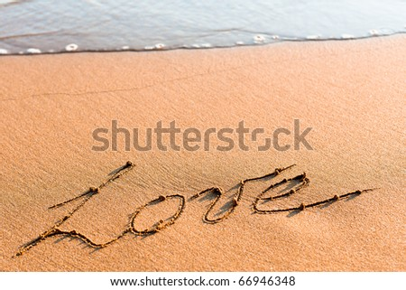Word LOVE on sand - stock photo