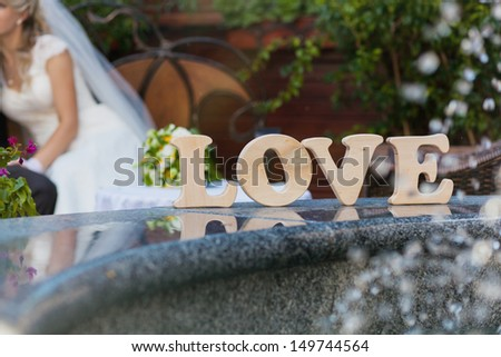 Word love on the background of the bride - stock photo