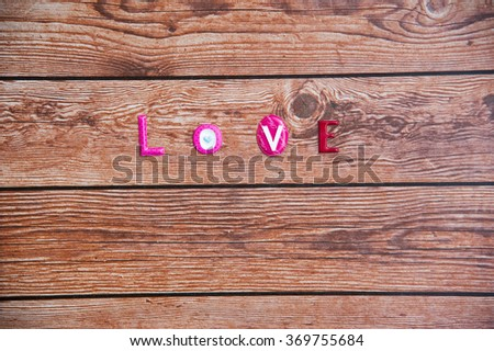 Word love on wooden background. Happy Valentines day, Motherâ??s day,Anniversary, sweet day, special day for special person. - stock photo