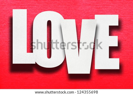 Word love with paper sticky valentines day concept on red background - stock photo