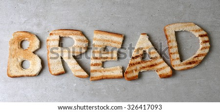Word made out of bread on the table