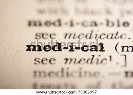 Word medical from the old dictionary, a close up. - stock photo
