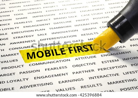 Word Mobile first highlighted with marker on paper of other related words.business success concept. - stock photo