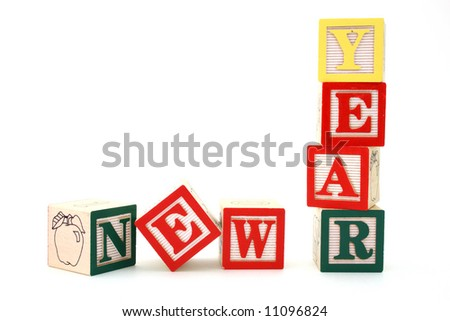 word new year formed by wood alphabet blocks