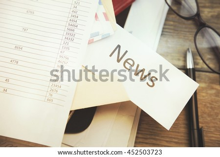 Word News; The Pile of Business Documents on the Desk