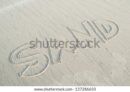 Word of sand written on sand