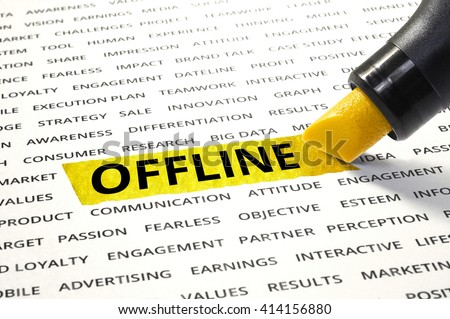 Word OFFLINE highlighted with marker on paper of other related words. For direction of business marketing concept - stock photo