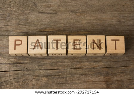 word patent on a wooden cubes - stock photo
