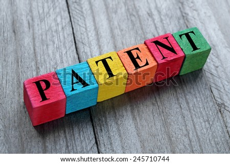 word patent on colorful wooden cubes - stock photo