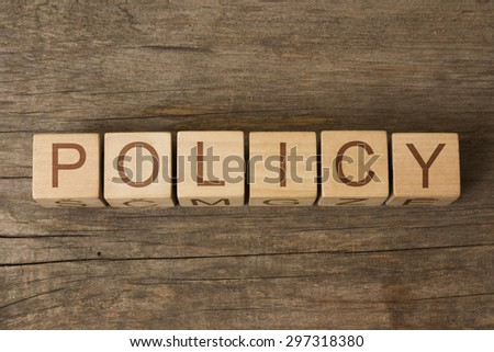 word policy on wooden cubes - stock photo