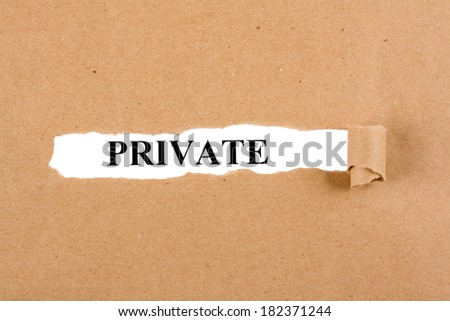 Word private appears under the torn brown paper - stock photo