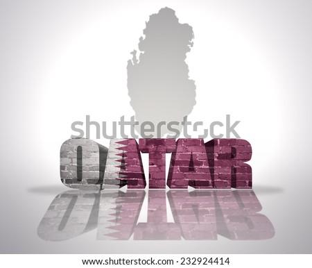Word Qatar with National Flag near map of Qatar - stock photo