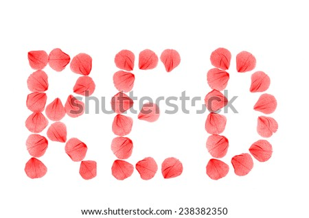 Word RED arranged from real dry rose petals.