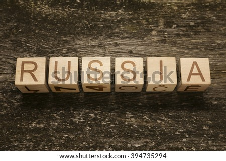 Word RUSSIA on a wooden background - stock photo