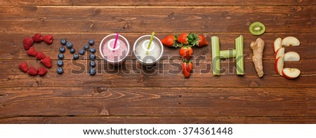 word smoothie made of fruits and vegetables on wooden background