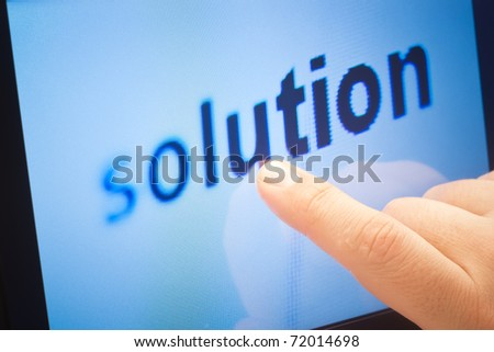 word solution on touch screen device - stock photo