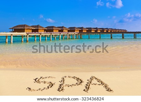 Word Spa on beach - concept holiday background