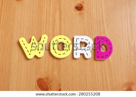 WORD, spell by woody puzzle letters with woody background - stock photo