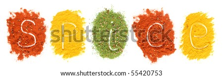 """Word """"Spice"""" drawing on colored spices background - stock photo"""