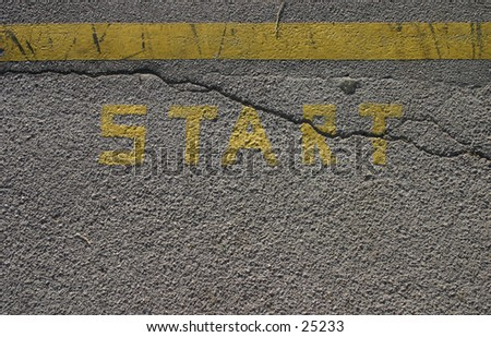Word start printed on an asphalt pavement, yellow line above