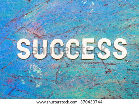 "word ""success"" designed by white letter press on blue retro background - stock photo"