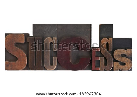 word success in vintage wooden letterpress type, scratched and stained, isolated on white background - stock photo