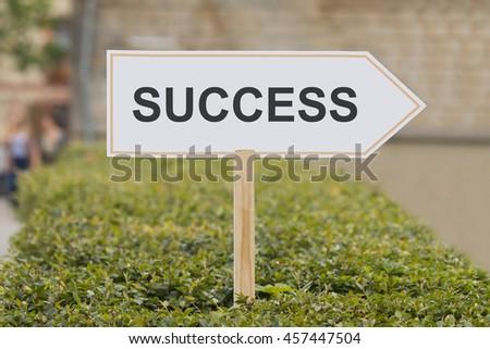 word success on signpost - stock photo