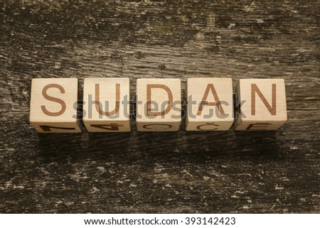 Word SUDAN on a wooden background